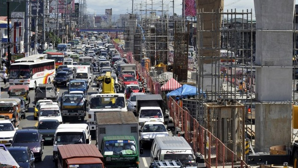 Manila street packed with cargo trucks