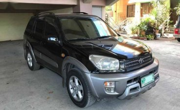 Selling Black Toyota Rav4 2000 in Quezon City