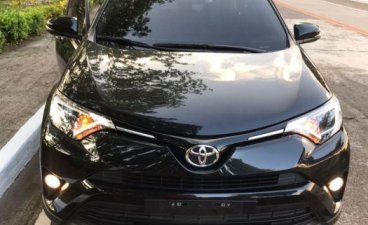 Selling Black Toyota Rav4 2016 Automatic Gasoline in Quezon City