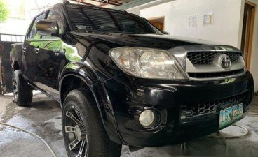 Black Toyota Hilux 2011 at 62000 km for sale