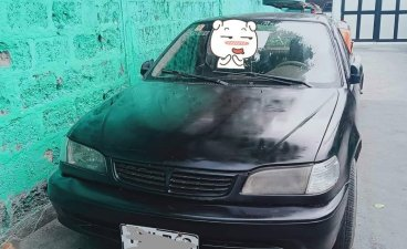 Black Toyota Corolla 1999 for sale in Manual