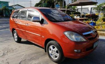 Orange Toyota Innova 2005 for sale in Manila