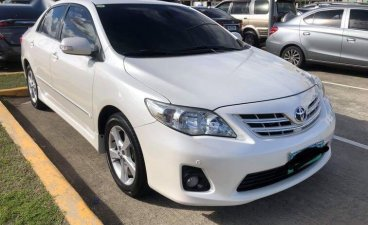 Pearl White Toyota Corolla altis 2012 for sale in Manila