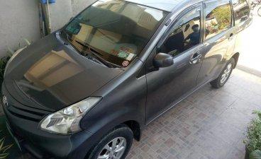 Selling Grey Toyota Avanza 2014 Van in Cainta