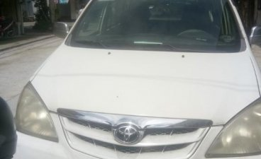 White Toyota Avanza 2010 for sale in Manila