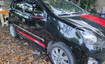 Selling Black Toyota Wigo 2014 in Cabuyao