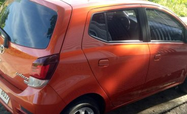 Selling Orange Toyota Wigo in Apalit