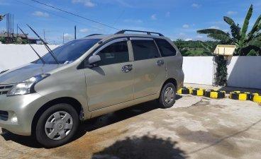 Selling Gold Toyota Avanza 2013 Van in Cavite City