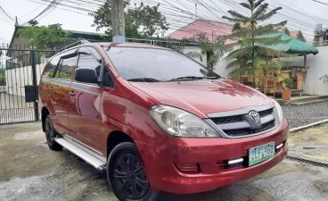 Red Toyota Innova 2007 SUV at 84000 km for sale in Manila