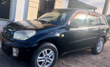 Selling Black Toyota Rav4 2003 in Limay