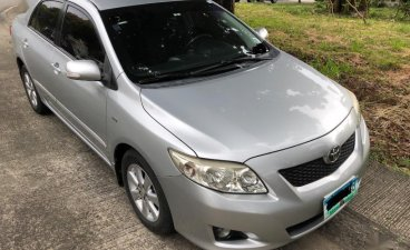 Brightsilver Toyota Corolla Altis 2010 for sale in Quezon