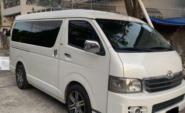 Pearl White Toyota Hiace Super Grandia
