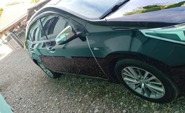 Sell Black 2014 Toyota Corolla Altis in Calamba