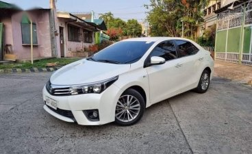 Selling White Toyota Corolla Altis 2016 in Caloocan