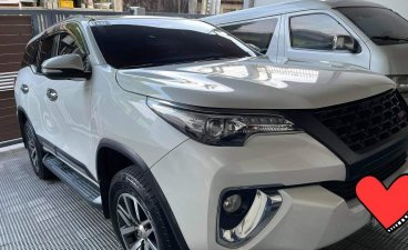 White Toyota Fortuner 2016