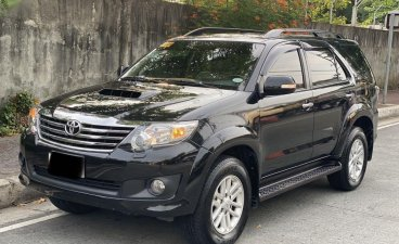Selling Black Toyota Fortuner 2014 in Quezon