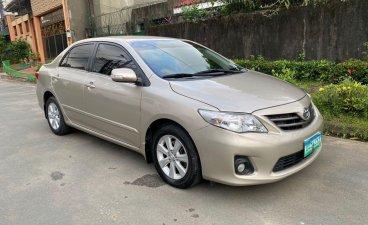 Selling Brightsilver 2013 Toyota Altis in Quezon
