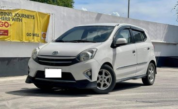 Selling Pearl White Toyota Wigo 2014 in Makati