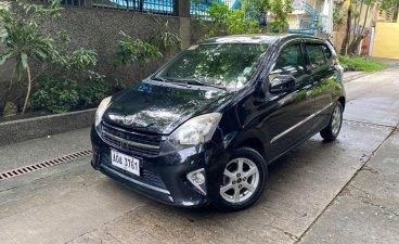 Selling Black Toyota Wigo 2015 in Quezon