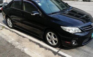 Selling Black Toyota Corolla Altis 2012 in Quezon