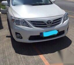 Pearl White Toyota Corolla Altis 2013 for sale in Silang