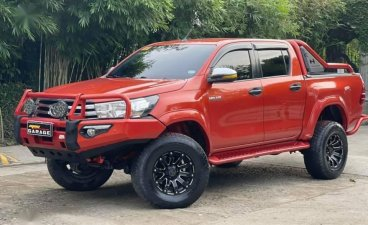 Selling Orange Toyota Hilux 2017 in Quezon City