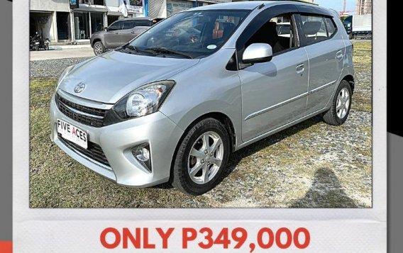 Selling Brightsilver Toyota Wigo 2016 in Mandaue